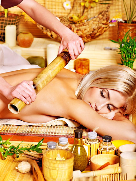 Young woman getting bamboo massage.jpg M