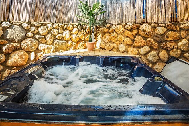 Bathtub -  jacuzzi in garden. Water in b