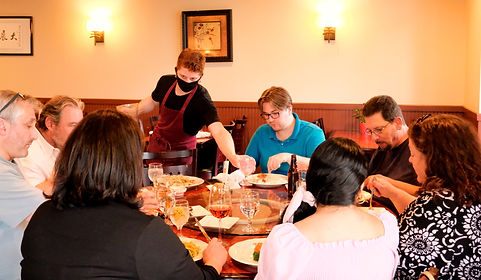 Customers and people eating at Mandalay Asian Fusion Cuisine Chinese Restaurant in High Point, North Carolina.