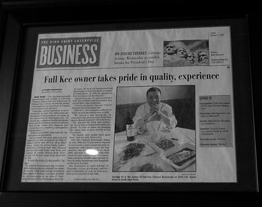 Newspaper clipping of Chef George Yu from Mandalay Asian Fusion Cuisine Chinese Restaurant in High Point, North Carolina.