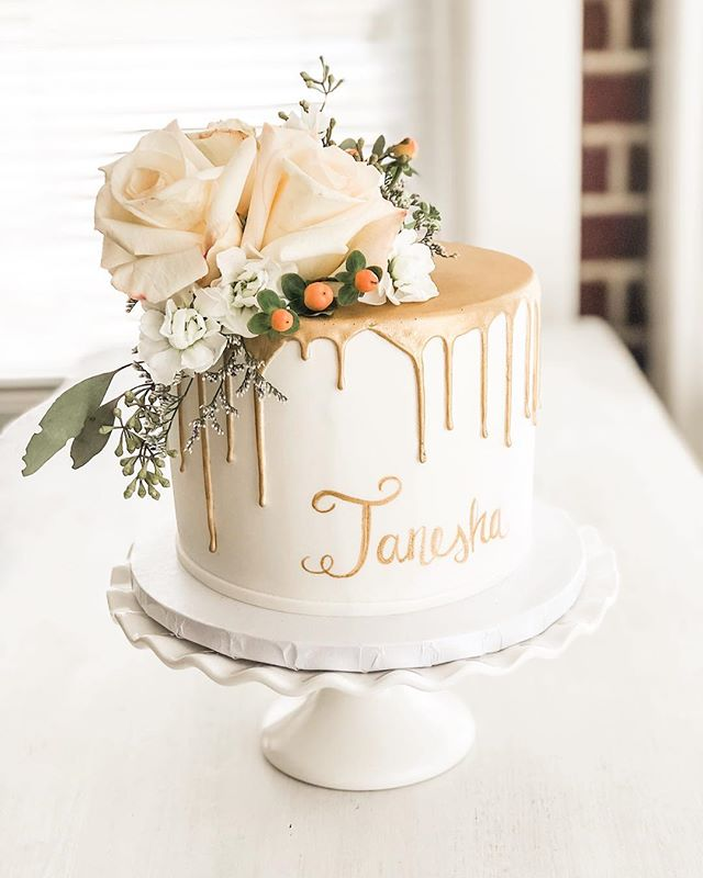 White & Gold bridal drip cake with fresh flowers
