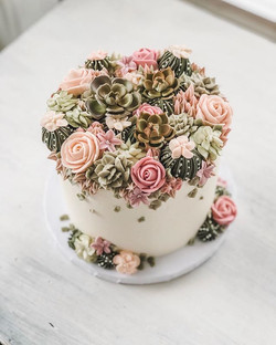 Bridal cake with buttercream and sugar flowers & succulents