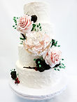 custom cake fondant white tiered with large floral arrangement cascading