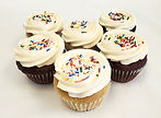 6 pack of assorted chocolate and vanilla cupcakes with sprinkles