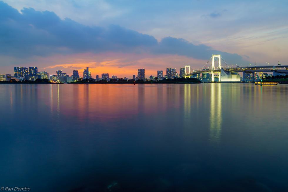 Sunset with city skyline and the Rainbow Bridge, Tokyo, Japan