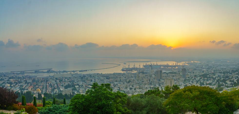 Sunrise panorama of downtown Haifa, the port, and the bay, Israel