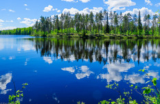 Landscape of lakes and reflections in Lapland, Finland