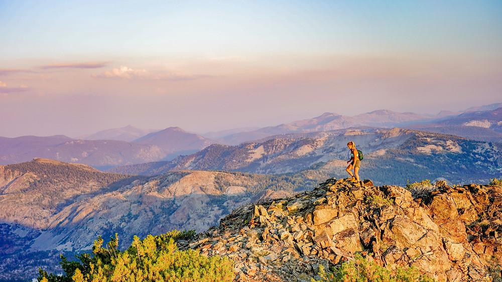Women hikes on ridgeline