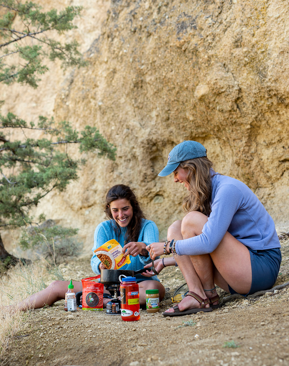 Girls cooking backcountry food