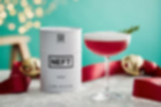 A festive NEFT cocktail beside a barrel of NEFT.
