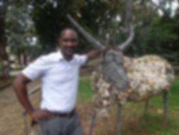 Adjei Agyei-Baah with antelope sculpture
