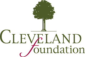 "The Cleveland foundation logo. At top: a green pillar tree. Below: Green text and red script ""f"" in foundation."