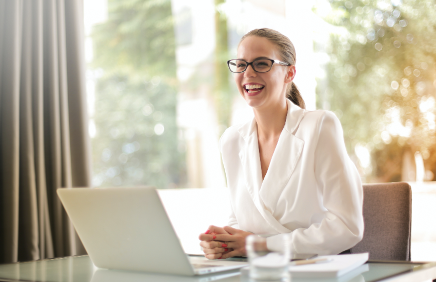 Woman smiling over her computer