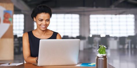 Woman looking at her laptop and smiling