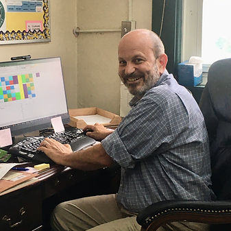 Principal Douglas Geogerian, smiling