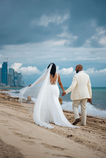wedding portrait of a couple in miami beach photography by villas channel clear blue sky long white dress