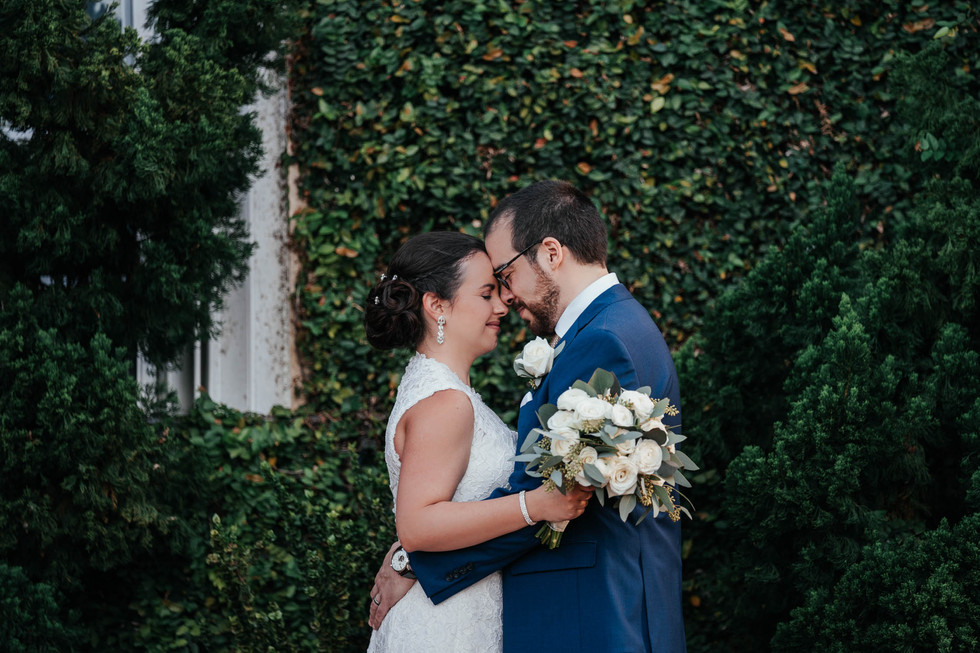 wedding photo bride and groom in greenery wall by villas channel in miami