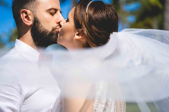 bride and groom photography kissing at wedding day photo by Villas Channel location Ocean Drive Miami beach