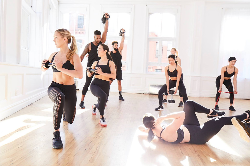 models, working out in new york city fithouse exercising and getting in shape. sweating for the soul.