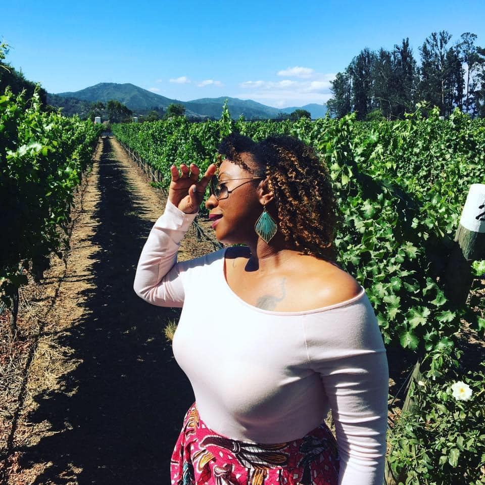 beautiful black woman basking under the sun in vineyard in Valparaiso, Chile