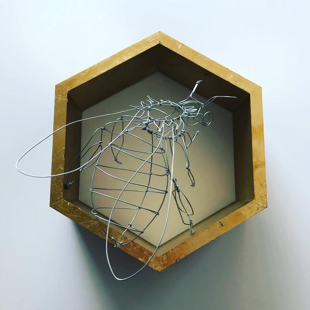 wire honey bee in golden comb
