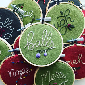 Pile of Hand Embroidered Snarky Ornament