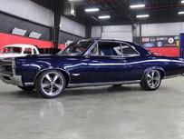 CLASSIFIEDS: 1966 Pontiac GTO, 400ci V8, 4 Speed Muncie, Full Frame-Off Resto $44,900