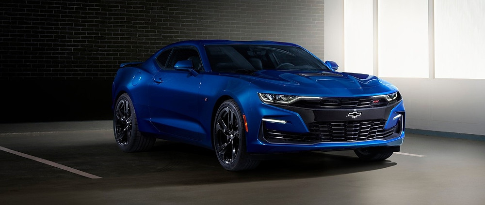 "2019 Camaro SS front fascia features a ""flowtie"" open bowtie grille emblem and aero-enhancing air curtains, plus specific headlamps with new LED signature and extractor-style hood."