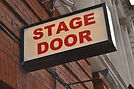 theatre-stage-door-sign-red-brick-wall-b