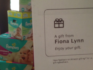 Fiona Lynn Sends Diapers to SWADDLE From Our Amazon Wish List