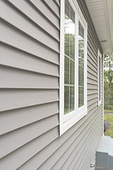 stock-photo-vinyl-siding-and-windows-on-