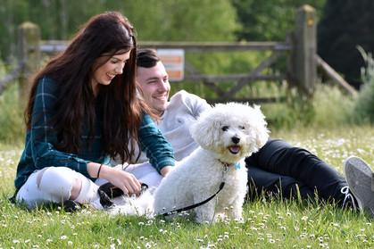 Couple with Bichon Frise dog