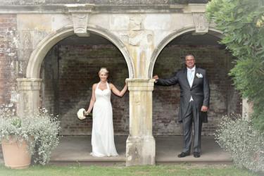 Bride and Groom under arch
