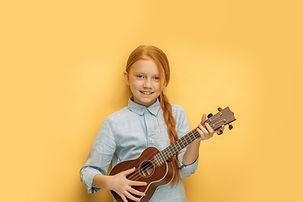 beautiful caucasian girl learns to play