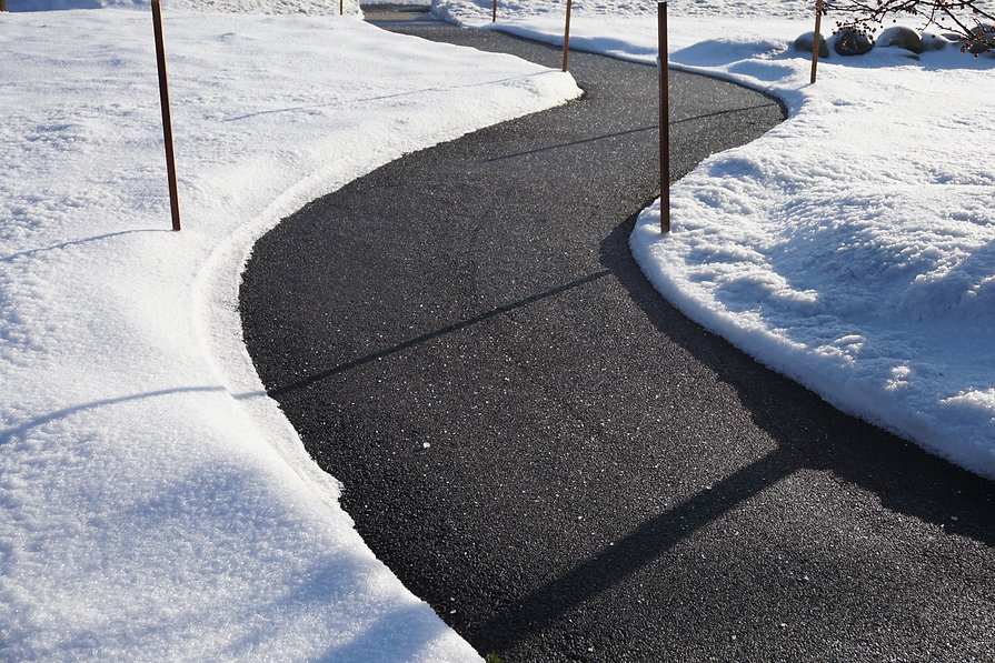 winding sidewalk after snow with snow re