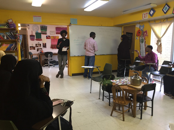 Students engage with their instructor at citizenship classes on Mondays, Wednesdays, and Fridays.