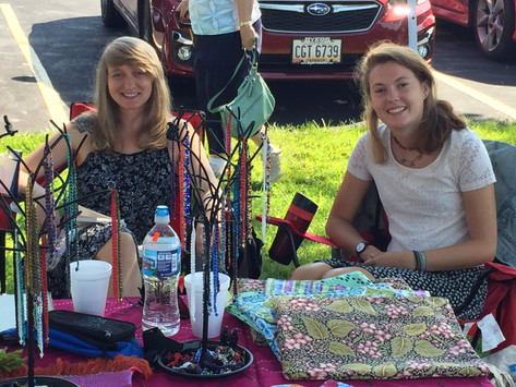 Social work interns sell crafts at a community festival