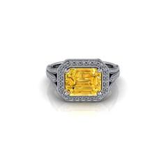 THREE CLAW-SET YELLOW DIAMOND RING