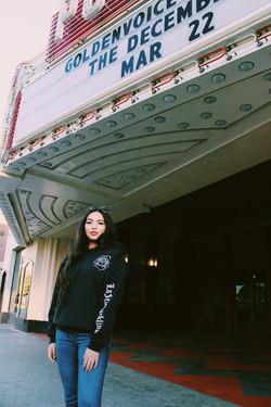 Model wearing black Rose Lens hoodie