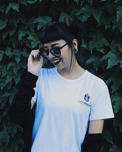 Model wearing white Lafeaduckling Photography tee
