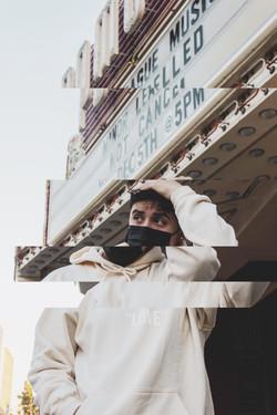 Model wearing Beige Love Yourself hoodie in size X-Large