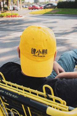 Model wearing yellow Lafeaduckling dad hat