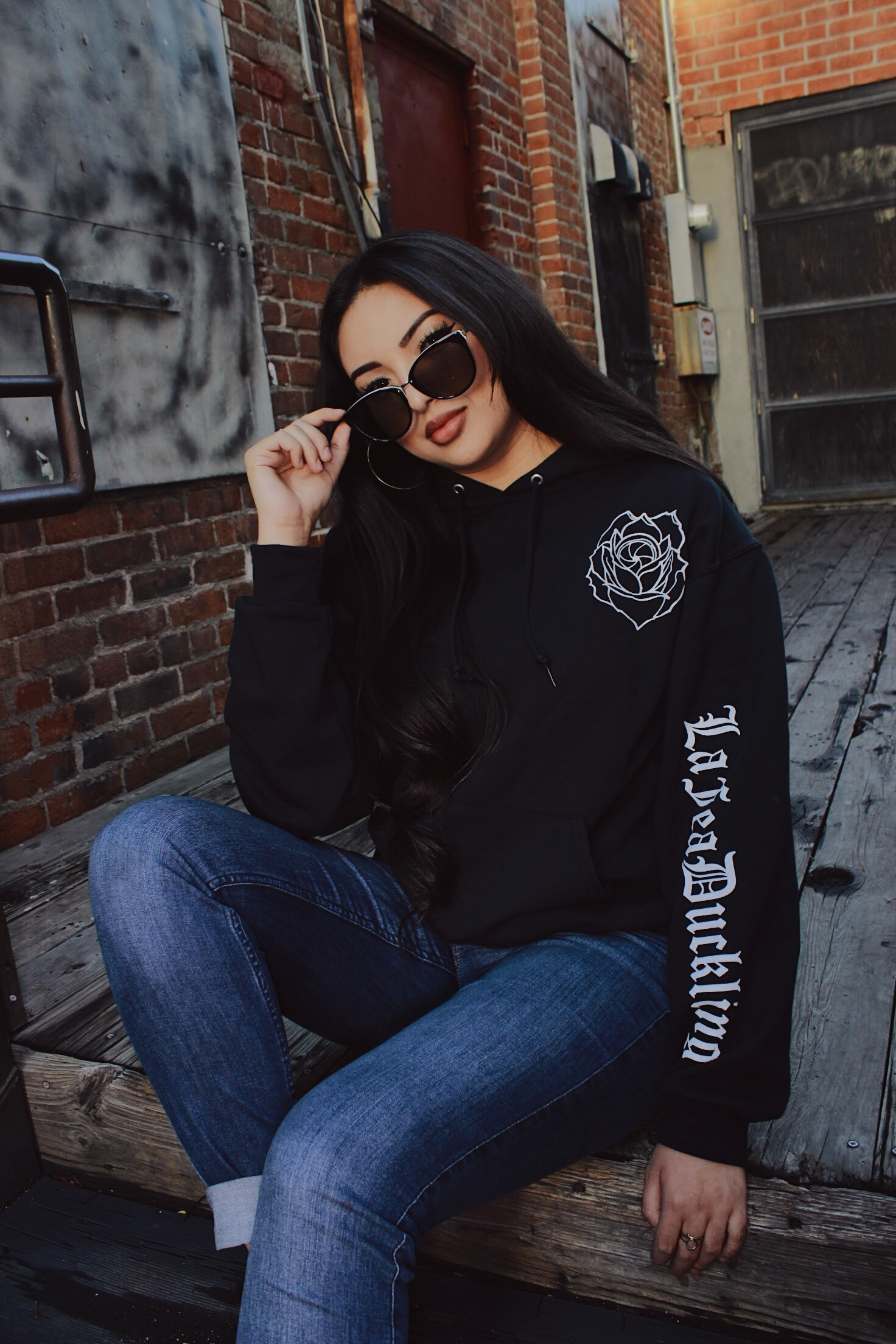 Model wearing black Rose Lens hoodie