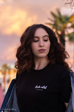Model wearing black Broke Artist tee