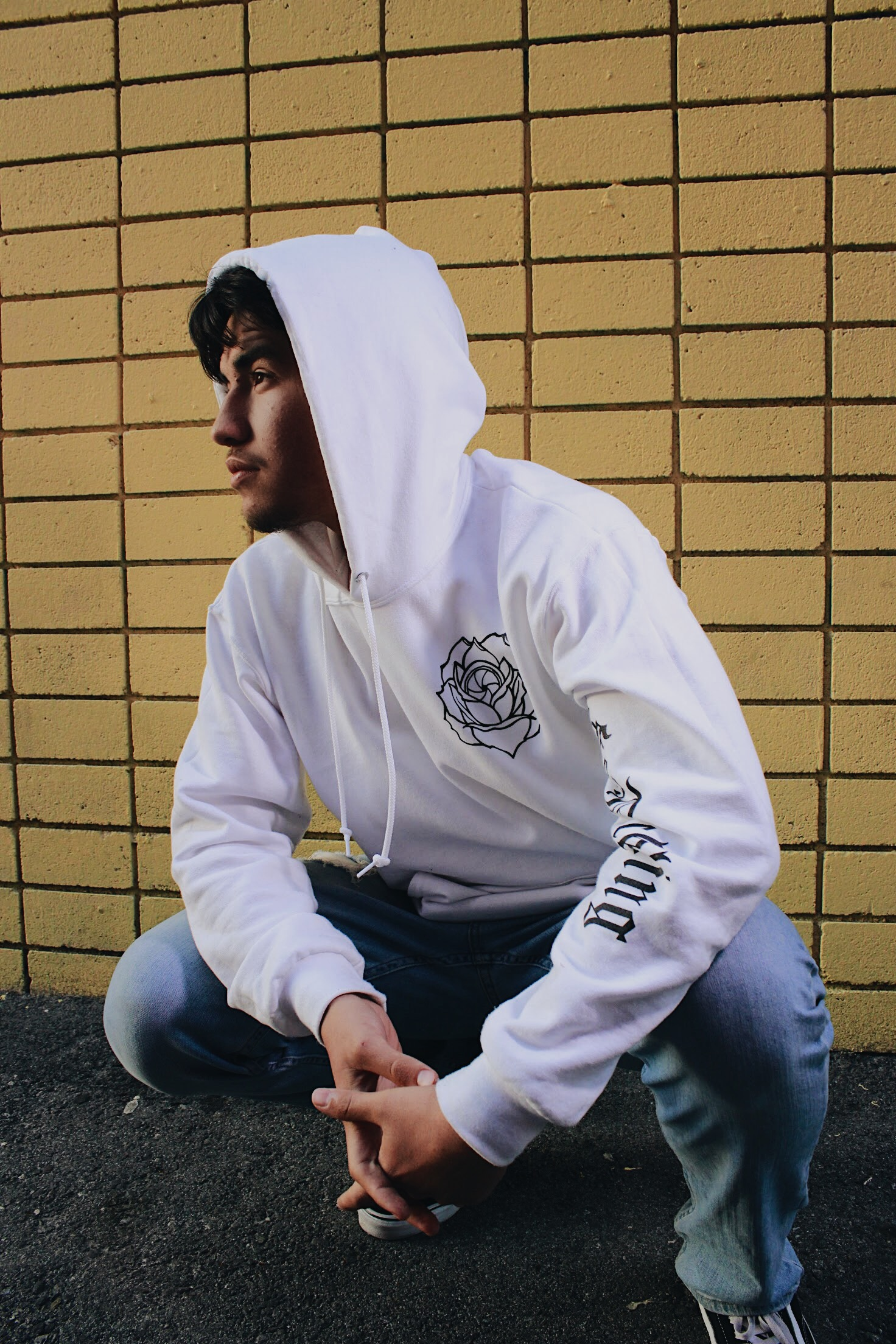 Model wearing white Rose Lens hoodie