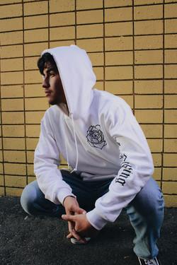 Model wearing white Rose Lens hoodie