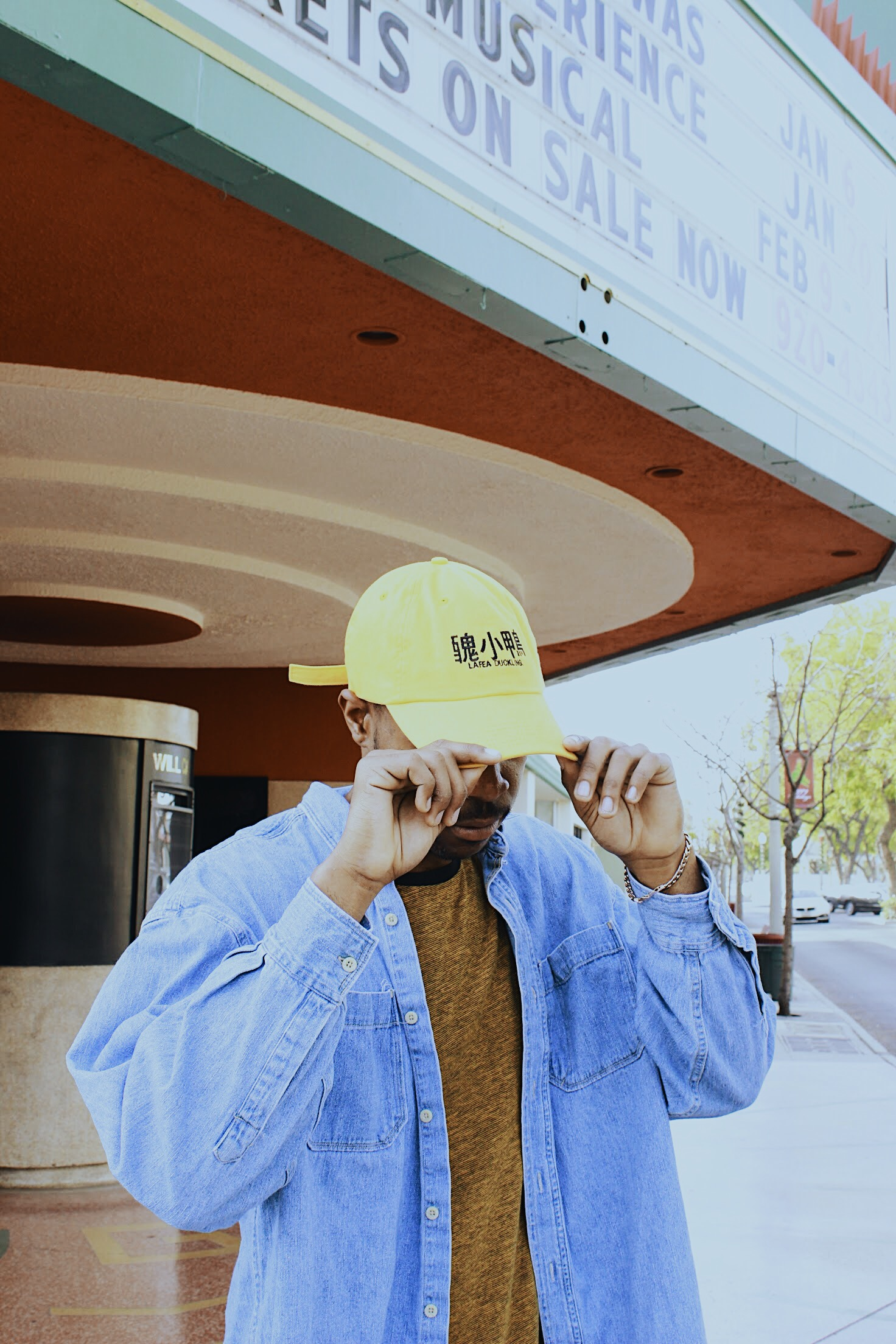 Model wearing yellow Lafeaduckling dad hat