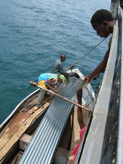 Ilala: unloading iron sheeting