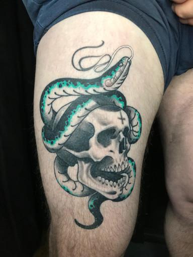 skull and snake thigh