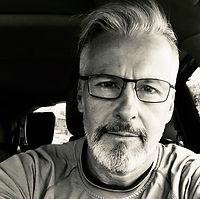 dan in car black and white.JPG